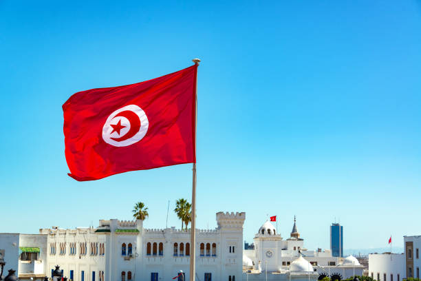 Tunisian Flag Waving in Tunis stock photo