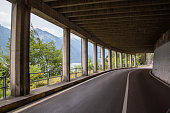tunnel at lake garda, Italy, blue water, wood and a small town