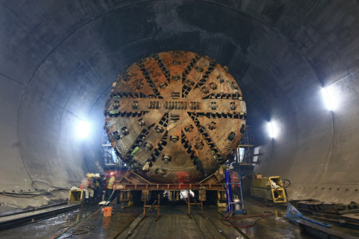 Tunnel Boring Machine (TBM) )that is being moved inside an underground tunnel.