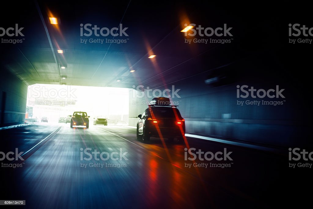 Tunnel drive to light at the end of business day stock photo