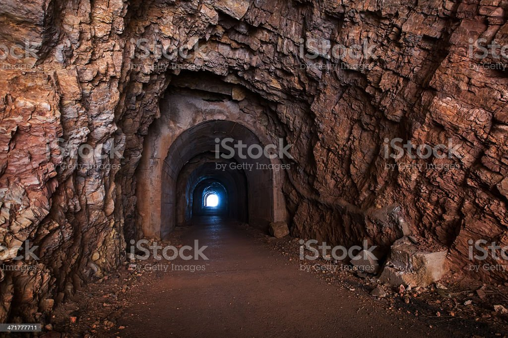 Tunnel interior perspective with glowing end royalty-free stock photo