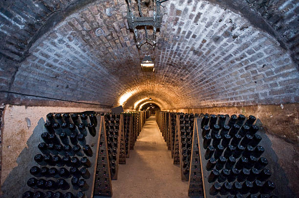 Tunnel Of Champagne A row of champagne bottles in an underground cellar epernay stock pictures, royalty-free photos & images