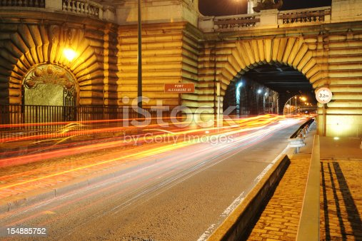 Long exposure photography of  high speed  traffic through the tunnel of Pont Alexandre III at night scene, Paris