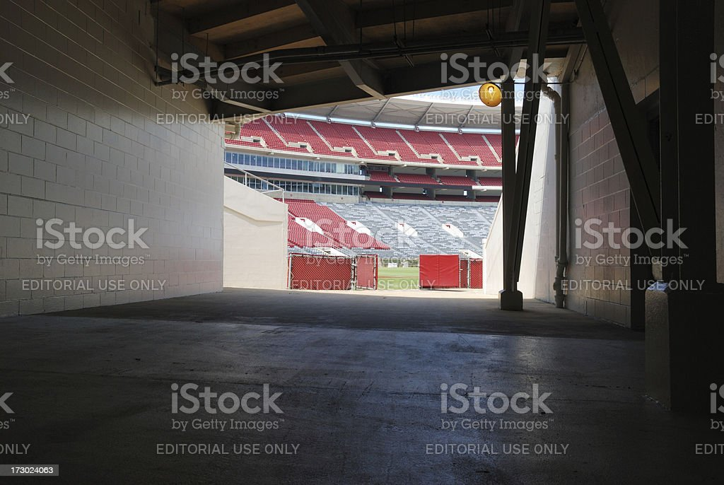 Tunnel onto football field end zone royalty-free stock photo