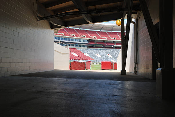 Tunnel onto football field end zone stock photo