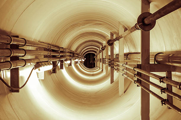 Tunnel Underground tunnel and steel pipe, beige color tone. confined space stock pictures, royalty-free photos & images