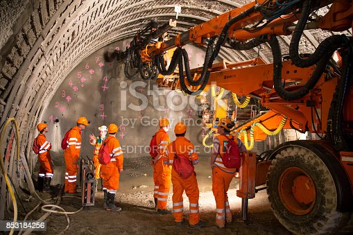 Geneva, Switzerland - May 22, 2014: Engineers and workers examinating the construction of piperoof grouting for tunnel construction