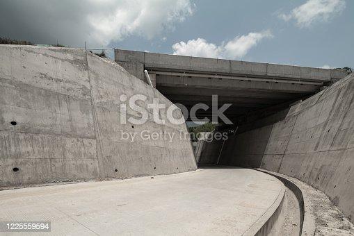 Tunnel road below highway