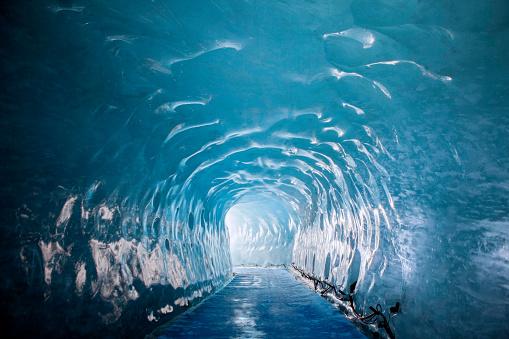 tunnel carved through glacier near mont blanc