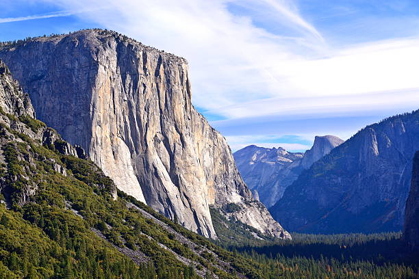 Tunnel View with El Capitan and Half Dome Tunnel View is a scenic overlook in Yosemite National Park. el capitan yosemite national park stock pictures, royalty-free photos & images