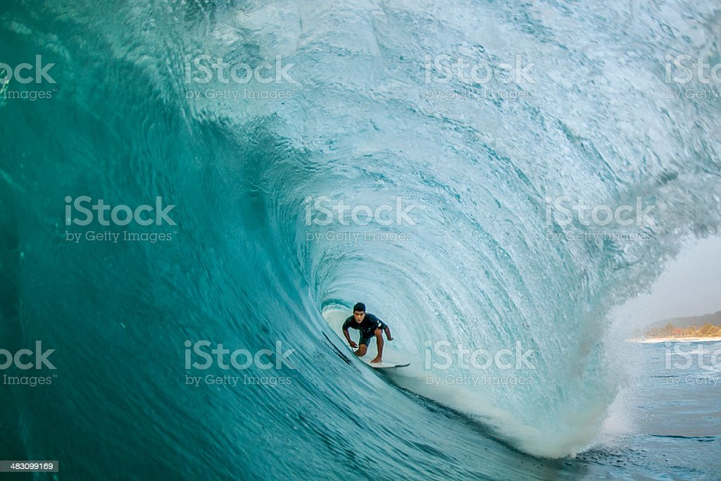 Tunnel Vision A professional surfer finds himself perfectly pitted deep within a North Shore barrel Aquatic Sport Stock Photo