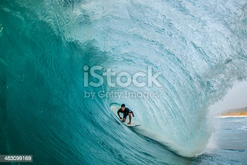 A professional surfer finds himself perfectly pitted deep within a North Shore barrel