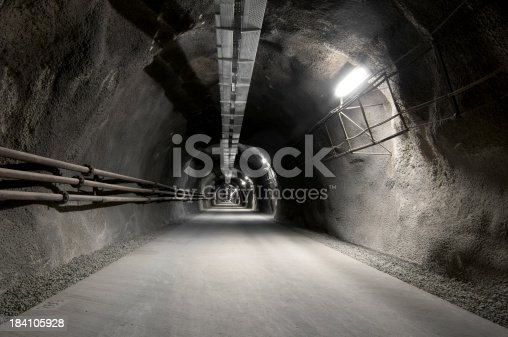 istock Tunnel with concrete road 184105928