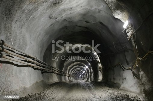 istock Tunnel with gravel road 183366866