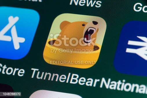 London, UK - July 31, 2018: The buttons of the app TunnelBear, surrounded by App Store, National Rail, News and other apps on the screen of an iPhone.