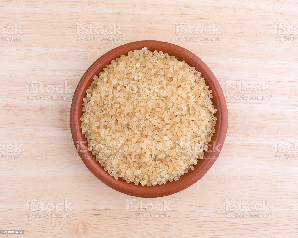 Turbinado sugar in bowl on a wood table top stock photo