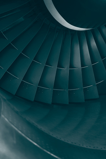 Turbofan aircraft jet engine turbine, green toned image