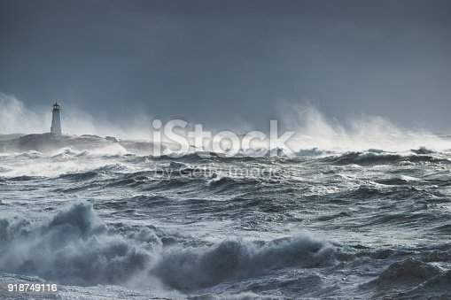 Giant waves break near the lighthouse at Peggy's Cove, Nova Scotia.