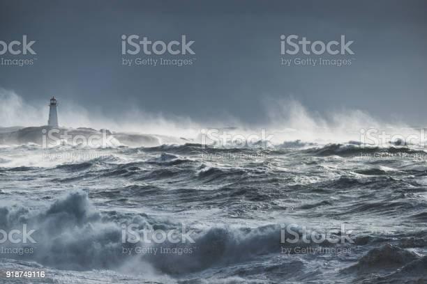 Photo of Turbulent ocean lighthouse