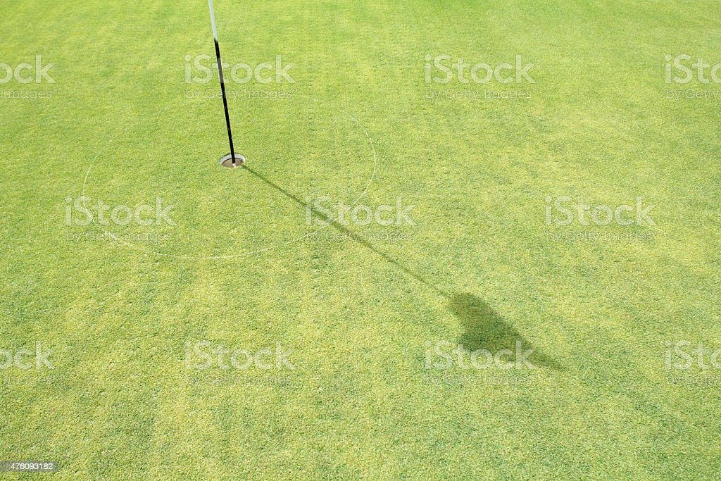 Turf core aeration on green golf. stock photo