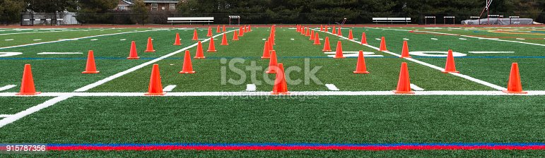 986840244istockphoto Turf field with orange cones set up for speed training 915787356