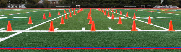 Turf field with orange cones set up for speed training stock photo