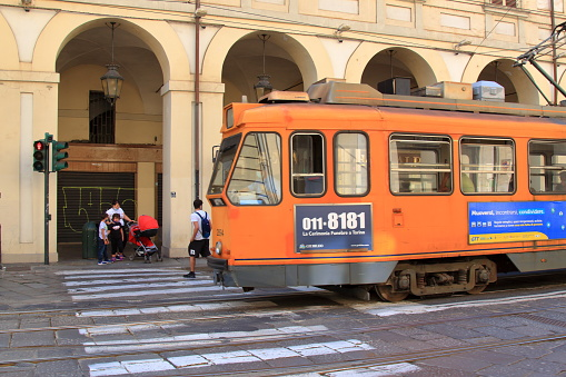 Turin, Italy: a classic vintage trolleybus crosses a crossroads in the central Via Po