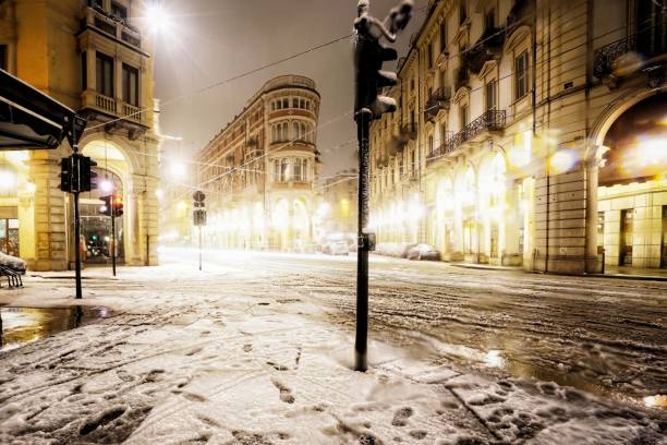 Turin italy piedmont under the snow at night in the city centre stock photo