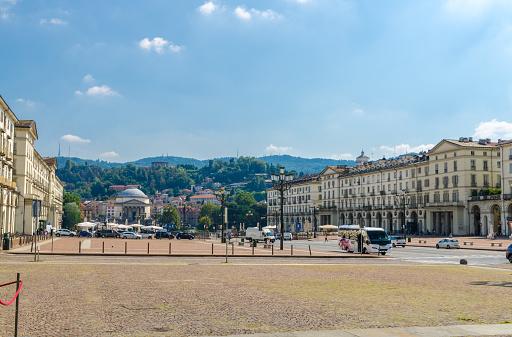 Turin, Italy, September 10, 2018: Piazza Vittorio Veneto is main square of Torino city, street lamp, old buildings and Catholic Parish Church Chiesa Gran Madre Di Dio, blue sky background, Piedmont