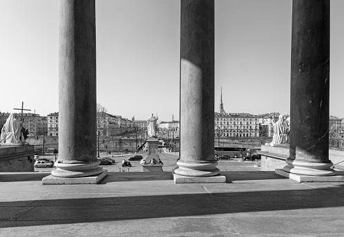 Turin - The bridge Vittorio Emaneule I and the City from portico of church Chiesa della San Madre di Dio.