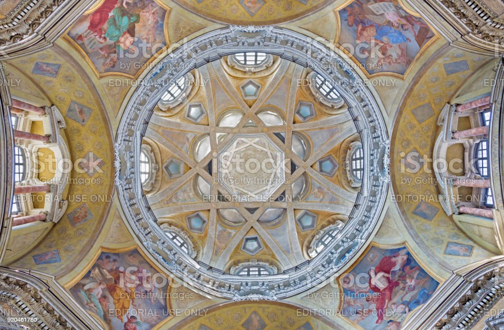 Turin - The cupola with the frescoes of the Evangelist in church Chiesa di San Lorenzo by Carlo Felice (1827). stock photo