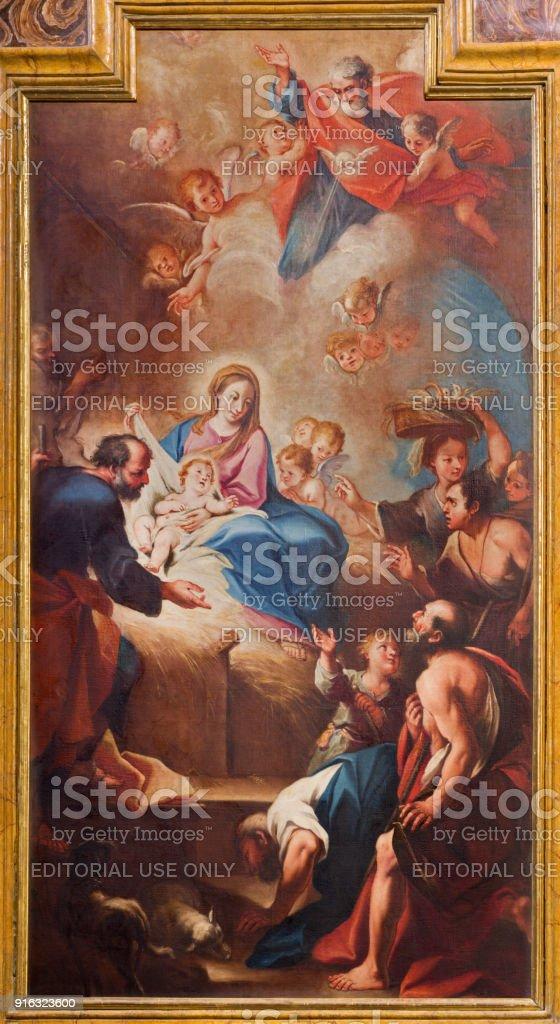 Turin - The painting of Nativity in church Chiesa di Santa Teresia by Sebastiano Conca (1730). stock photo