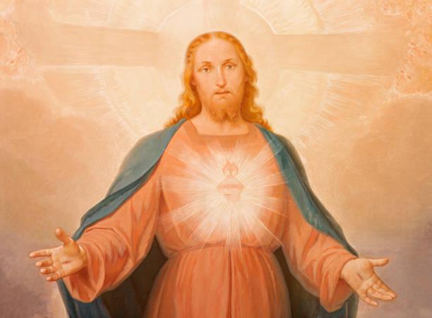 Turin - The painting of Sacred Heart of Jesus in church Chiesa di Santa Maria della Consolazione by Luigi Guglielmino (1885 - 1962). stock photo