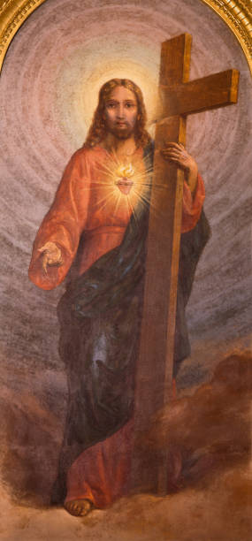 Turin - The painting of Sacred Heart of Reserrected Jesus with the cross in church Basilica Maria Ausiliatrice by Carlo Morgari (1939). stock photo
