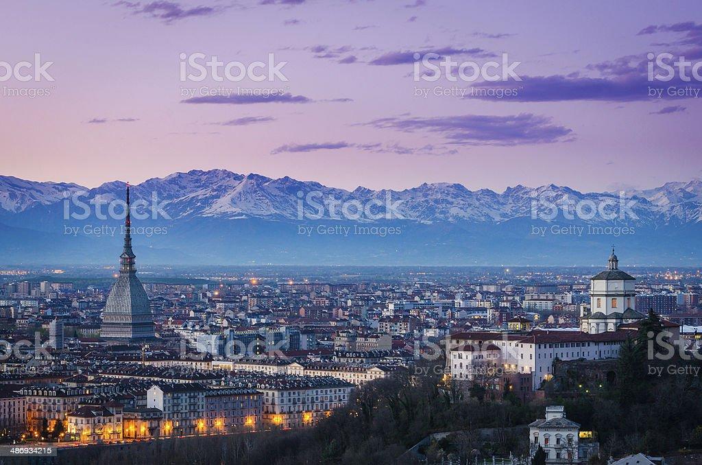 Turin (Torino), twilight panorama with Mole Antonelliana and Alp stock photo