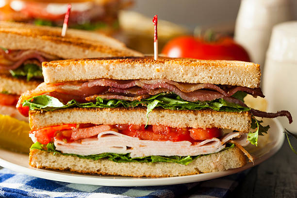 turkey and bacon club sandwich - club sandwich stock photos and pictures