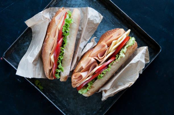 turkey and cheese sandwich - panino ripieno foto e immagini stock