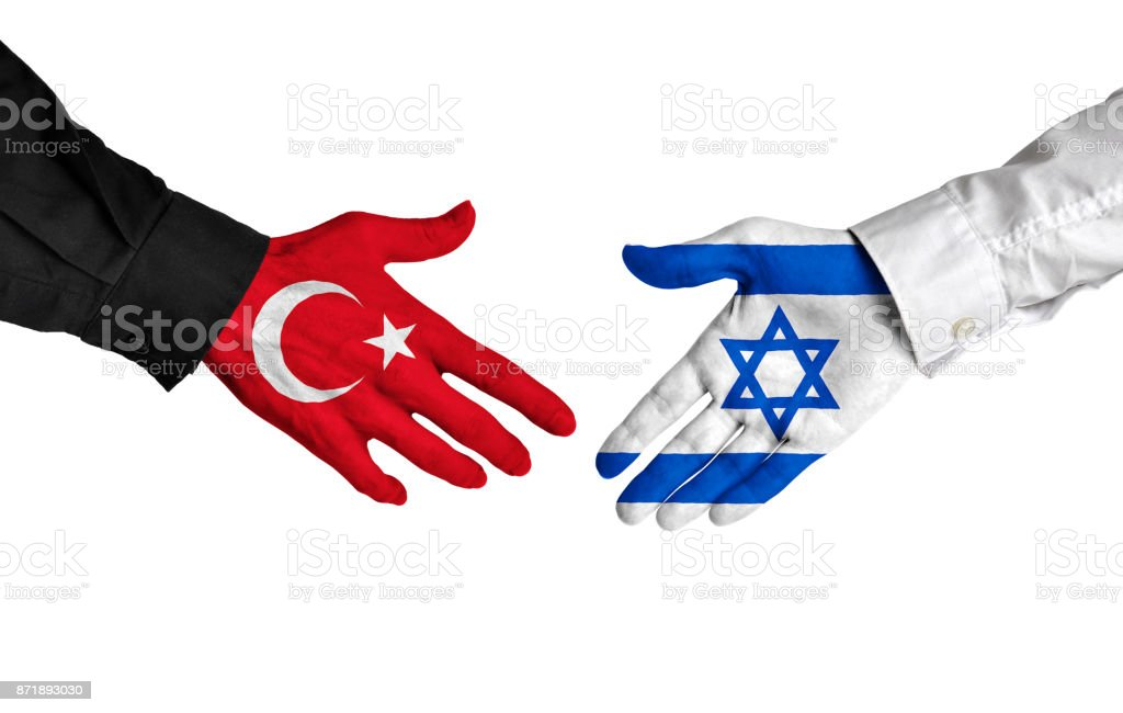 Turkey and Israel diplomats shaking hands for political relations stock photo