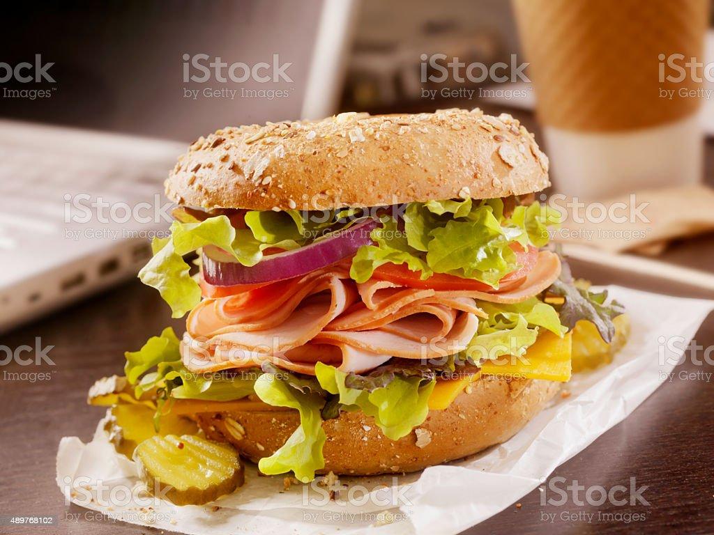Turkey Bagel Sandwich at your Desk stock photo