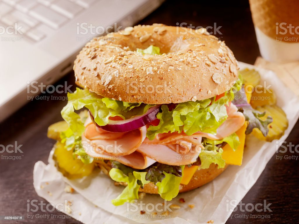 Turkey Bagel Sandwich at your Desk stock photo