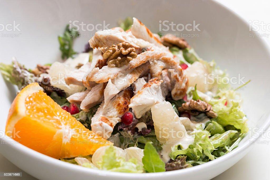 Turkey breast salad with walnut and pomelo stock photo