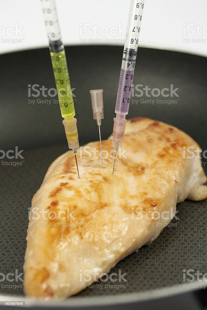 Turkey breast with syringes royalty-free stock photo