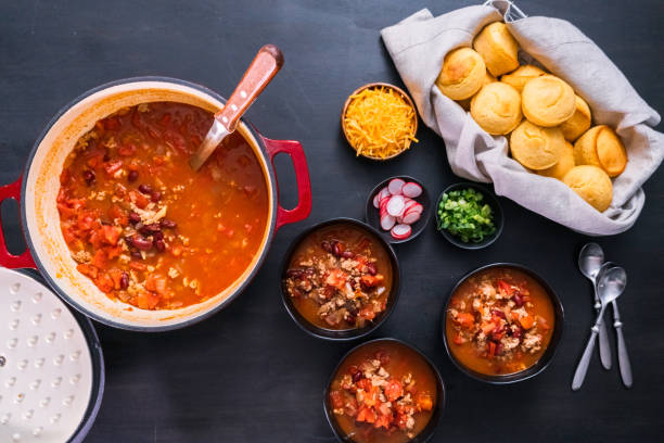 Turkey chili garnished with fresh radishes Turkey chili garnished with fresh radishes, green onions and cheddar cheese chili con carne stock pictures, royalty-free photos & images