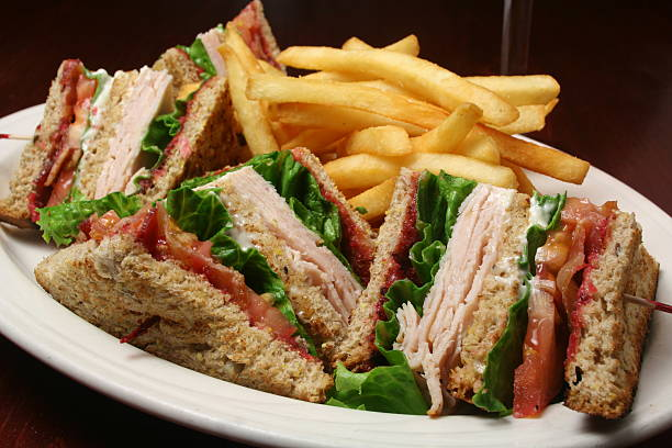 turkey club sandwich and fries - club sandwich stock photos and pictures