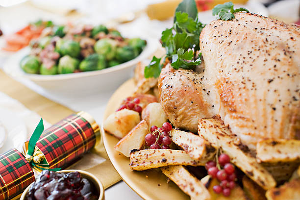 Turkey, cranberries and Christmas cracker on table stock photo