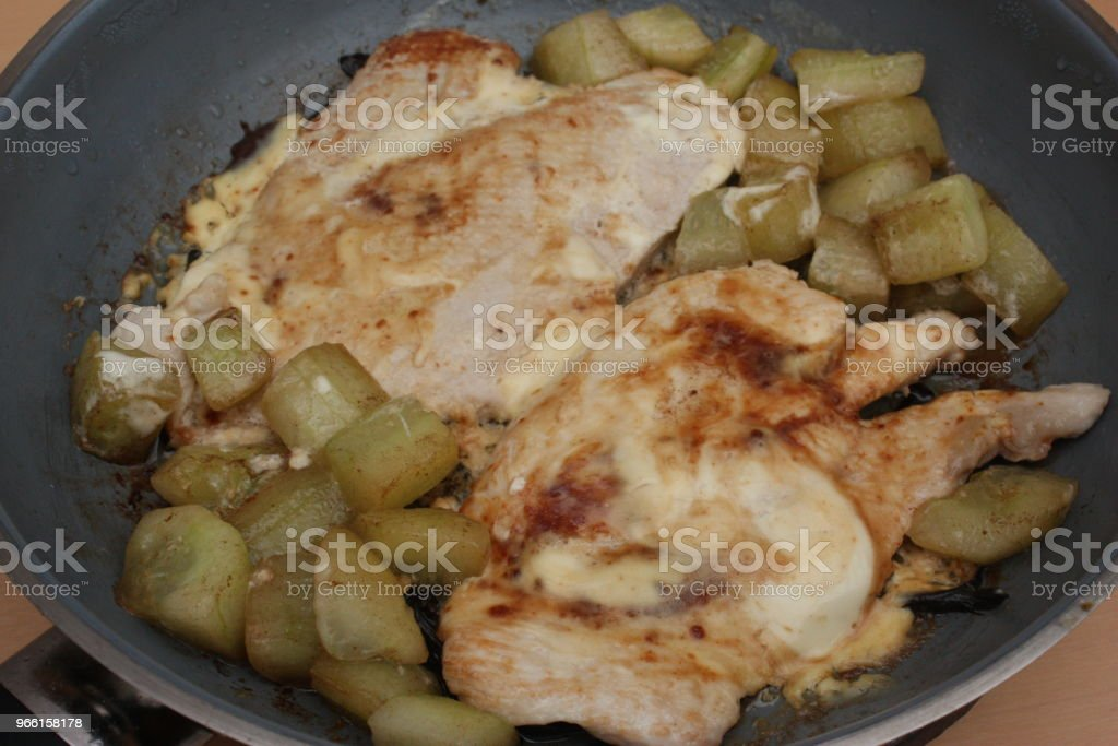 Turkey escalope cooked with fresh cream and cucumber - Royalty-free Cooking Stock Photo