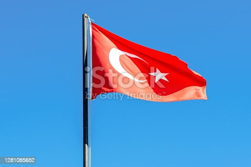 Turkey flag waving on the wind. red turkish flag on flagpole dark blue sky background. concept of tourism and politics