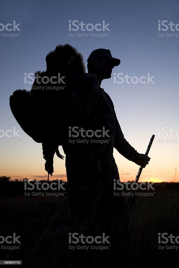 Turkey hunter silhouette at sunset royalty-free stock photo