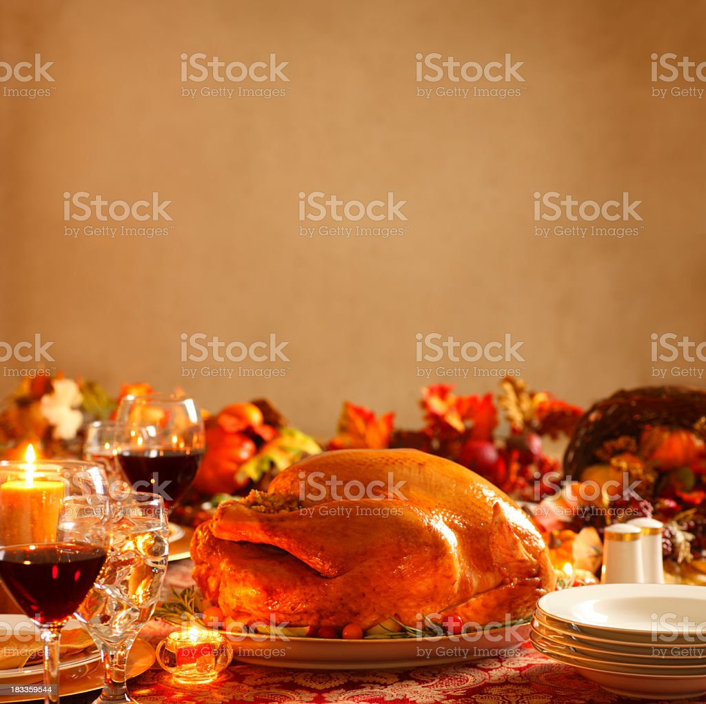 Turkey on platter in a Thanksgiving dinner setting royalty-free stock photo