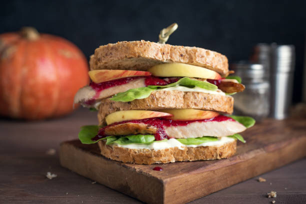 Turkey or Chicken leftover sandwich Turkey or Chicken leftover sandwich with stuffing and cranberry sauce. Freshly made from Thanksgiving or Christmas turkey leftovers on crusty wholemeal bread. leftovers stock pictures, royalty-free photos & images